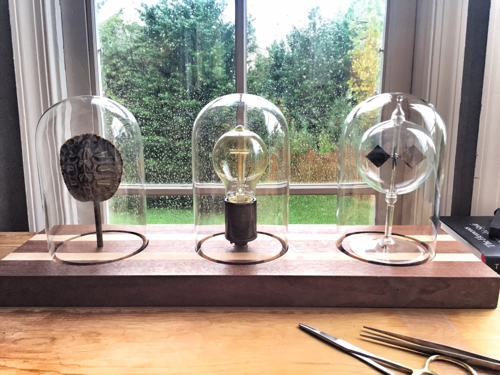 One of my favorite new lighting creations - triple dome light on handmade walnut, featuring a Crooke's radiometer that spins when the light comes on.