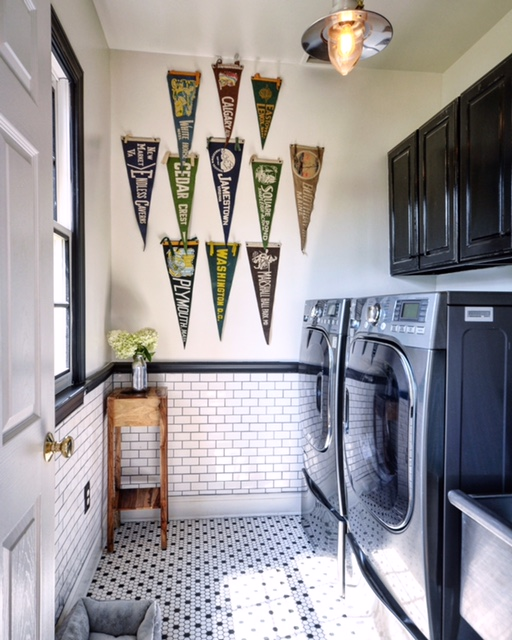 Vintage pennant collection adds interest in a black & white laundry room