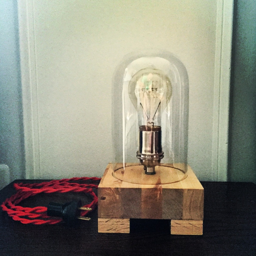 Sample table lamp from our new line of lighting. Recycled butcher block base with vintage-style red cord.