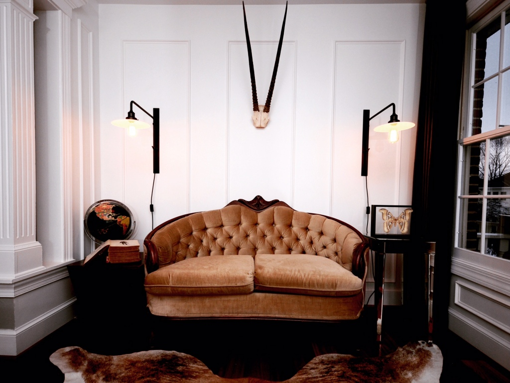 Vintage sofas and our beloved kudu anchored our design for the Cottage at Sweet Clover.